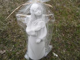 Anioł dziewczynka z eucharystią